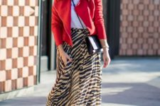With white t-shirt, red jacket, crossbody bag and leather boots