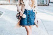 With white top, beige long jacket, bag and beige pumps