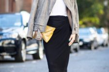 With white top, jacket, yellow clutch and sneakers