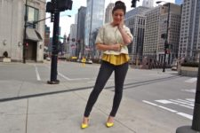 With yellow blouse, skinny pants and yellow pumps