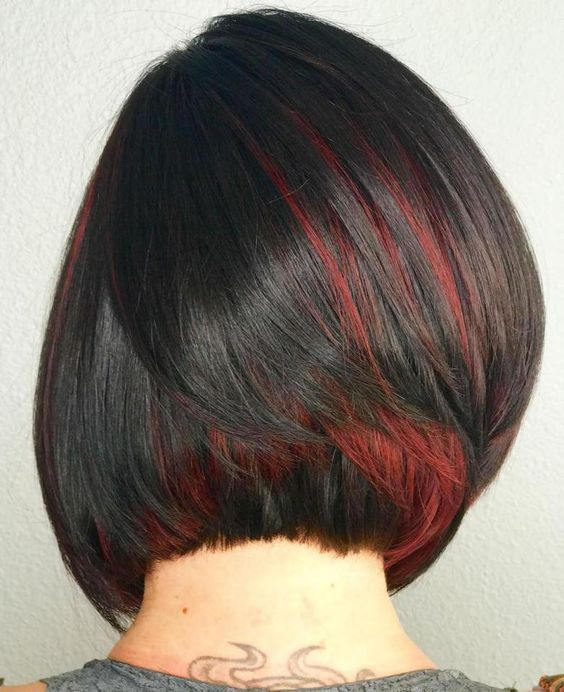 a black short bob with red peekaboo highlights for a passionate and bright look