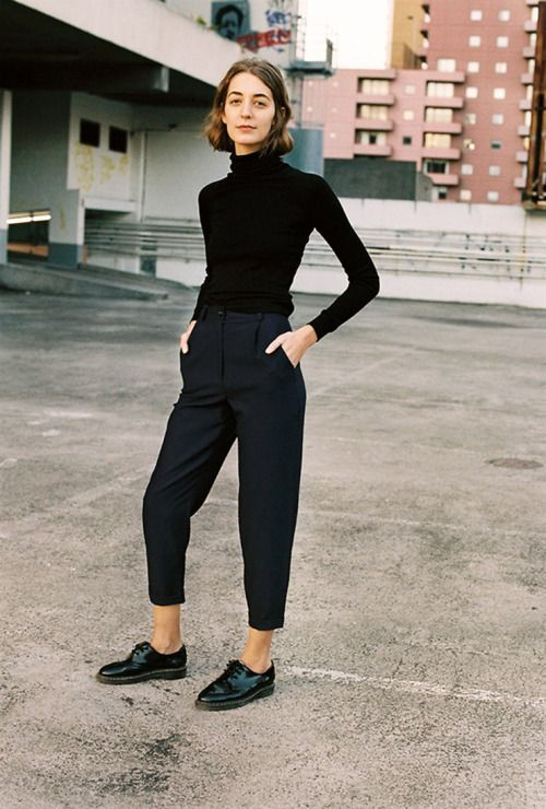 a black turtleneck, high waisted navy cropped pants, black flat shoes for a comfy work look