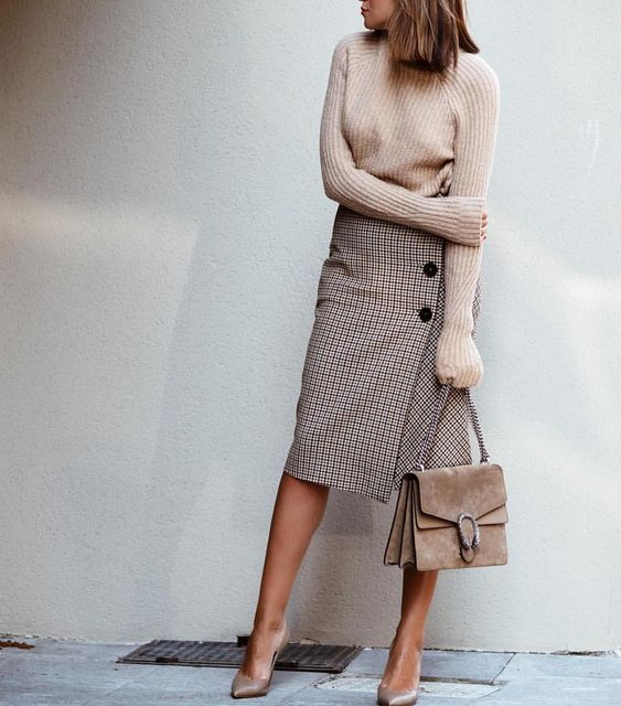 a blush sweater, a plaid skirt, nude heels and an elegant suede bag for winter