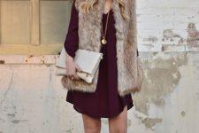02 a chiffon burgundy over the knee dress, grey shoes, a faux fur waistcoat, a neutral clutch bag