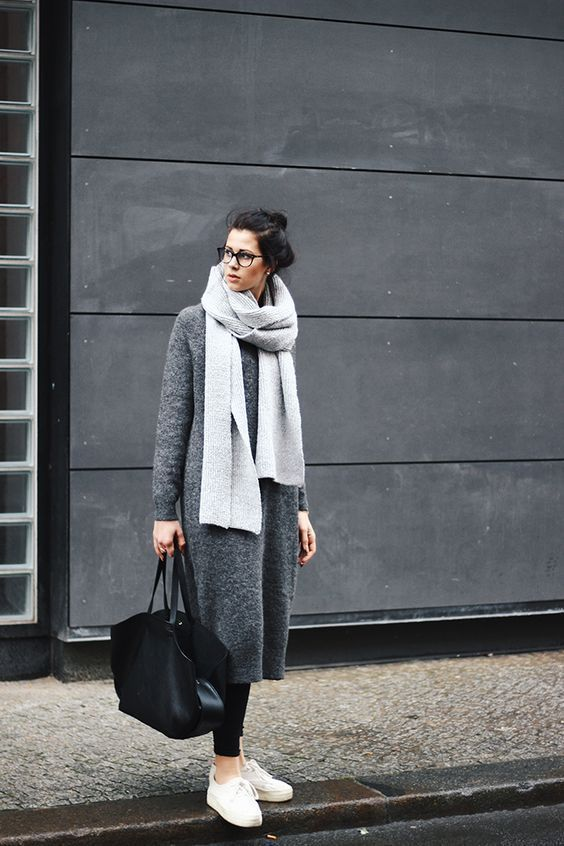 a dark grey midi sweater dress styled with black leggings, white sneakers, a black bag and a grey scarf for a comfy winter look