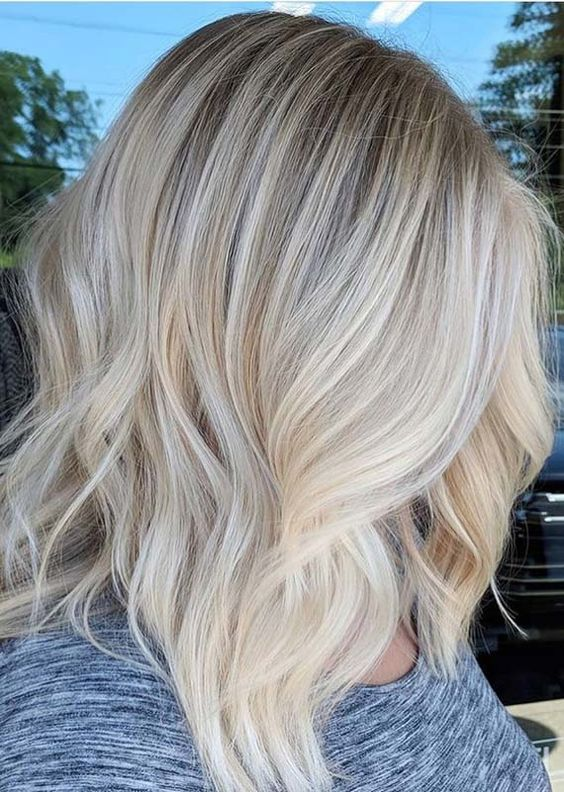 ash blonde is a natural idea for those who love cold blonde shades, and it's very trendy right now