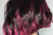 03 a black wavy angled bob with hot pink peekaboo highlights looks super contrasting