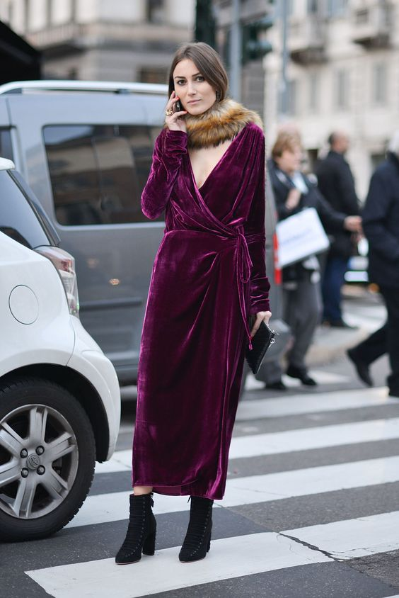 a fuchsia velvet wrap midi dress with a plunging neckline, a faux fur scarf and black booties for a statement