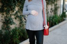 03 a grey off the shoulder sweater, black leggings, black boots and a red bag plus blue earrings