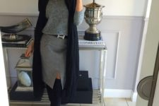 03 a grey skirt with a front slit, a grey sweater, a navy scarf, navy tall boots for a chic look
