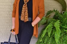 03 a navy jumpsuit, a rust cardigan, leopard flats and a scarf, a blue bag and statement earrings