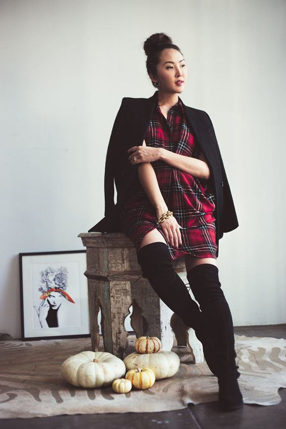 a plaid shirtdress, a black blazer, black tall boots and a chain bracelet for a touch of chic
