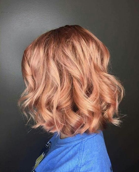a wavy strawberry blonde bob is a chic idea, and a bob is a timeless hair idea