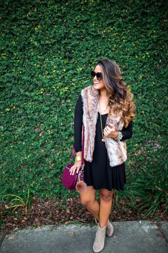 a navy over the knee dress, grey booties, a faux fur vest and a fuchsia bag for fall
