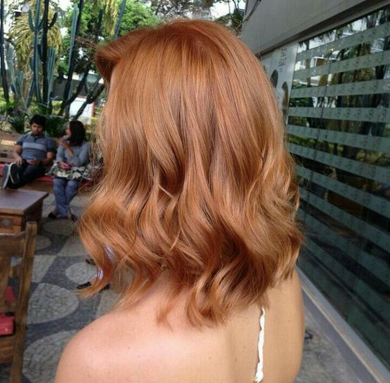 a strawberry blonde long bob with waves is a chic idea and a trendy length for now