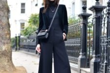 04 a total black look with culottes, a turtleneck, a velvet blazer and heels