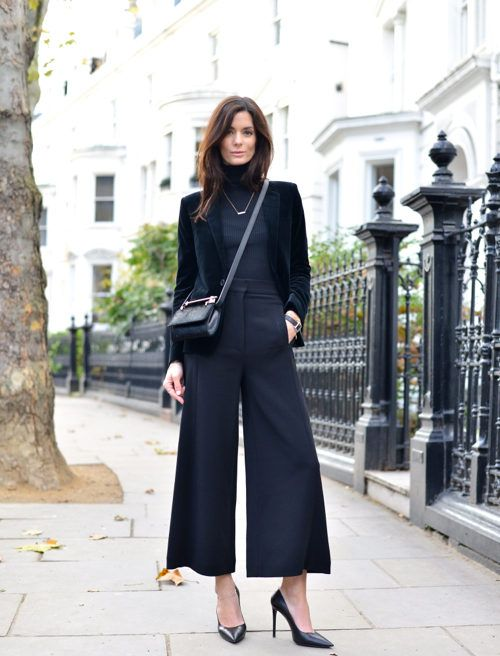 a total black look with culottes, a turtleneck, a velvet blazer and heels