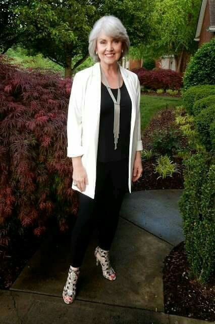 black leggings, a black top, a creamy long blazer, a statement necklace, strappy heels