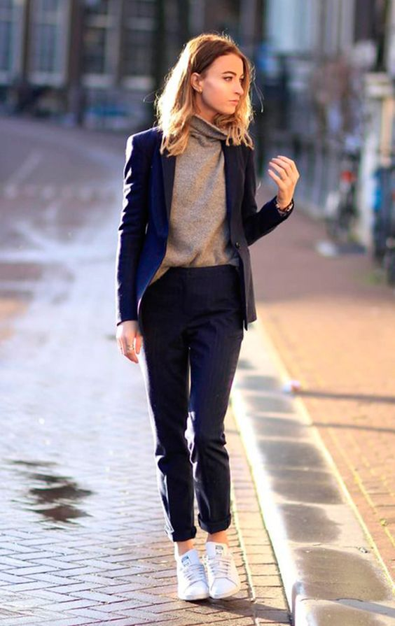 a navy pantsuit, a neutral turtleneck and white sneakers for a super trendy work look