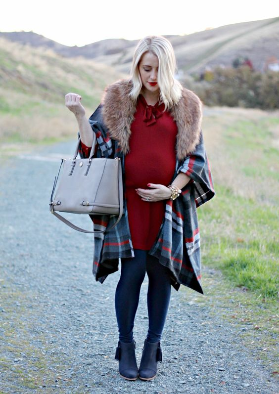 a red over the knee dress with a bow, navy tights, navy booties, a checked cape with faux fur and a bag