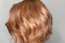 05 a short and shiny strawberry blonde bob with waves is a chic idea for every girl