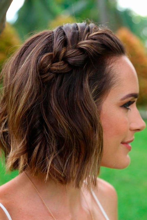 a short wavy bob with a waterfall braid on top for a trendy boho chic feel in your look
