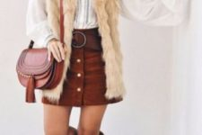 05 a white boho shirt, a rust mini skirt with buttons, brown booties, a saddle bag and a neutral fur waistcoat
