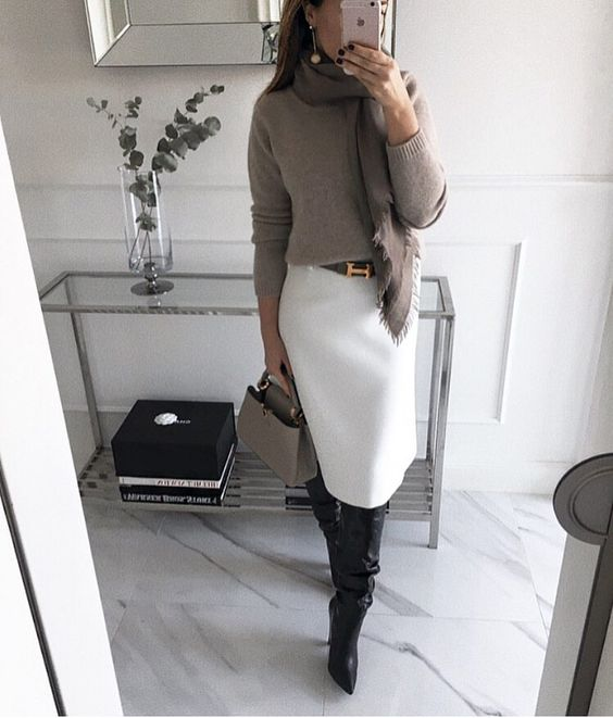 a white skirt, a grey sweater, a brown scarf, black boots, a grey bag and statement earrings
