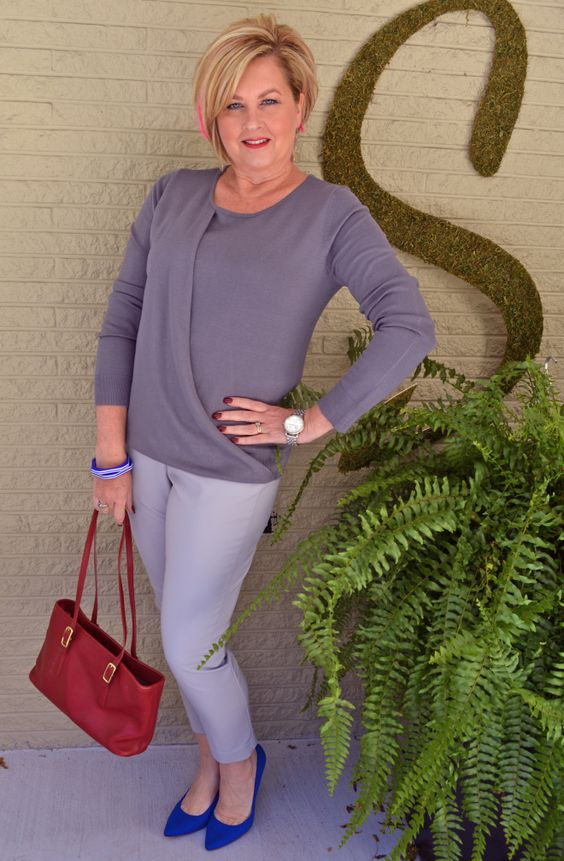 grey pants, a wrap taupe top, electric blue shoes and a red bag for a business casual look