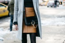 06 a black sweater, a brown leather skirt, a grey coat and black booties for office
