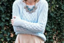 06 a neutral skirt, a powder blue sweater and a matching beanie plus a statement necklace for a vintage feel
