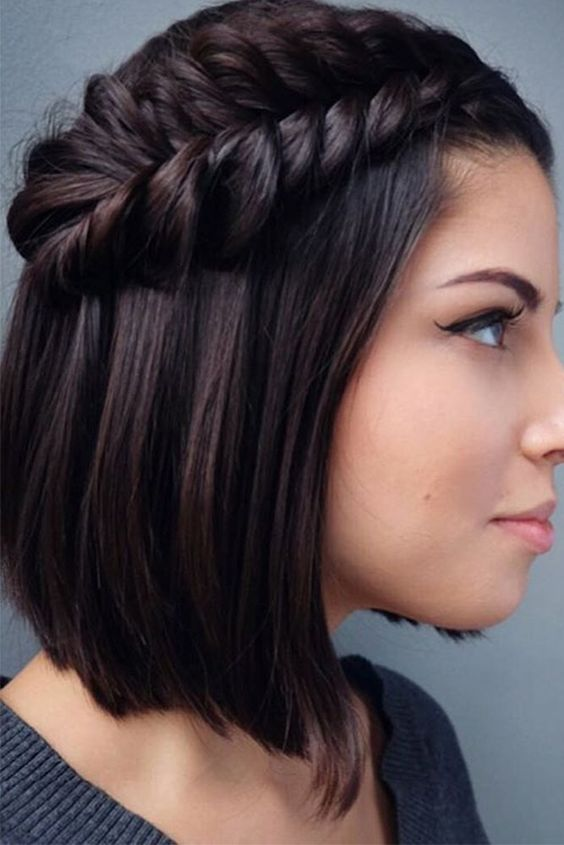 a short angled bob with a side fishtail braid that makes a stylish statement