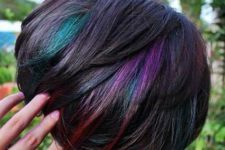 short layered hairstyle with colorful highlights
