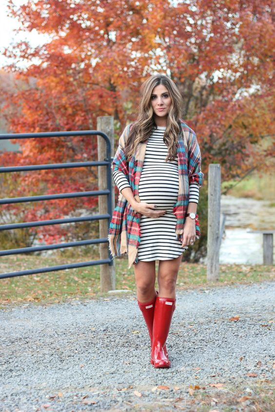 a striped over the knee dress, red rubber boots, a checked scarf as a coverup for a comfy fall look