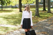 06 a white bell sleeve top, a high waisted plaid pleated skirt, black shoes and stockings