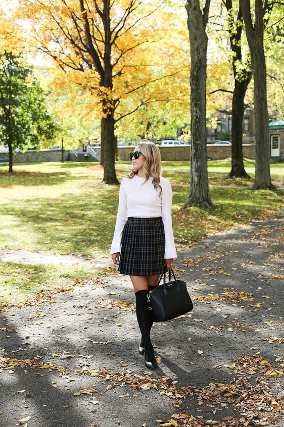 a white bell sleeve top, a high waisted plaid pleated skirt, black shoes and stockings