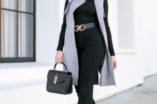 06 high waisted pants, a black turtleneck, a long grey waistcoat and a black bag for a glam feel