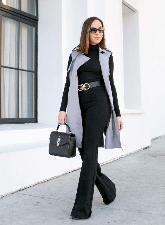 high waisted pants, a black turtleneck, a long grey waistcoat and a black bag for a glam feel