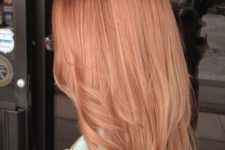 06 medium length strawberry blonde hair with light waves and a slight cascade for a chic look
