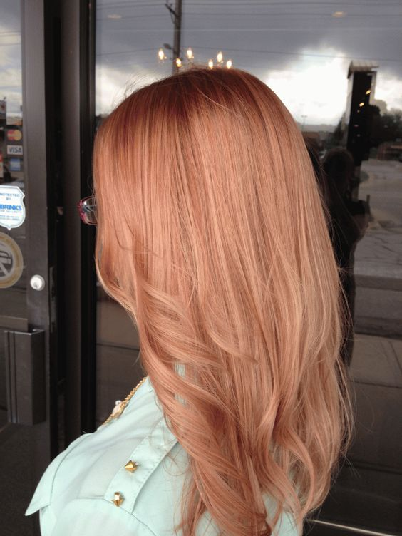 medium length strawberry blonde hair with light waves and a slight cascade for a chic look