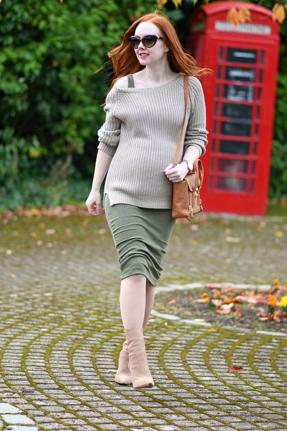nude sock boots, an olive green midi dress and a grey sweater and a brown bag