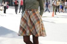 07 a green printed long sleeve top, a colorful plaid A-line skirt and neutral wedges