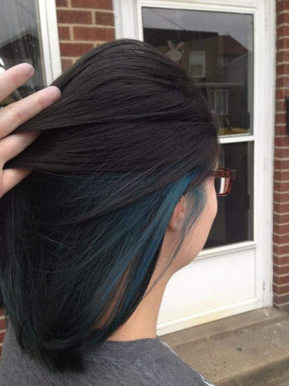 a long black bob with teal highlights that make a statement when seen