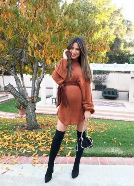 a rust sweater dress with a velvet sash, black tall boots, a small black bag to feel Thanksgiving