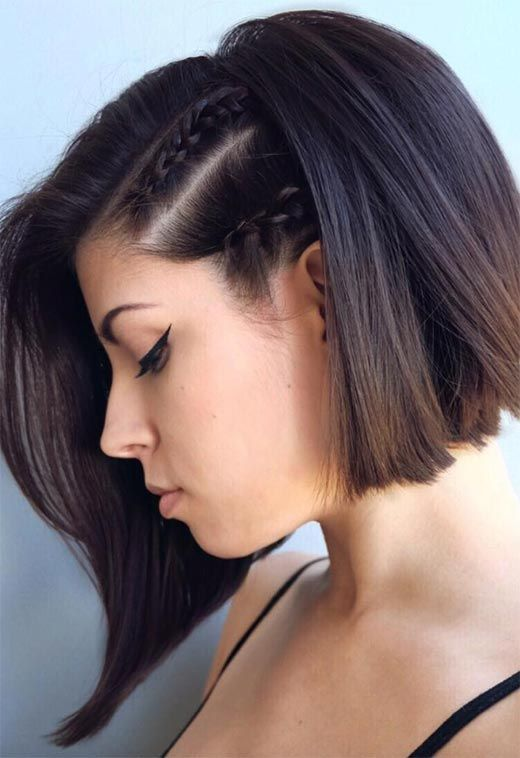 a short angled bob with two braids on the side for a trendy and edgy look