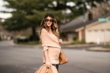 07 black skinnies, a nude wrap sweater, a white top, nude heels and a camel coat