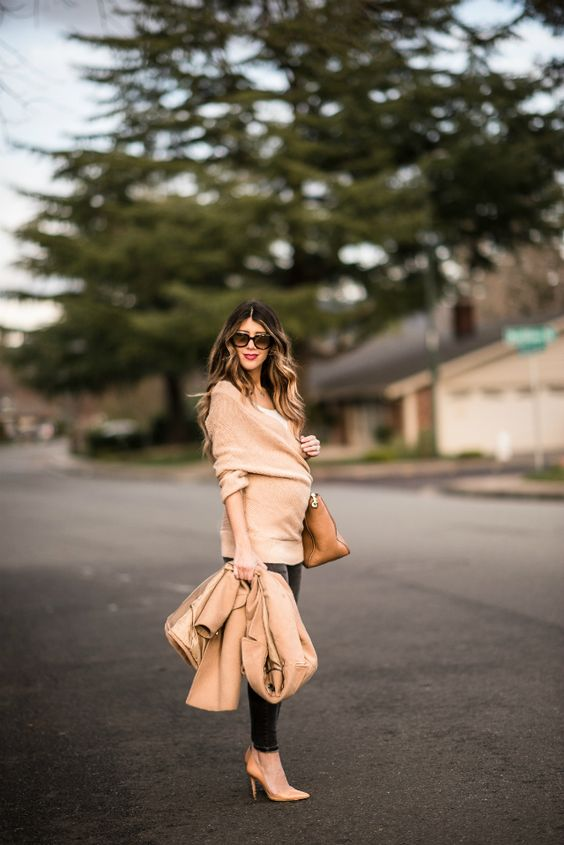 black skinnies, a nude wrap sweater, a white top, nude heels and a camel coat