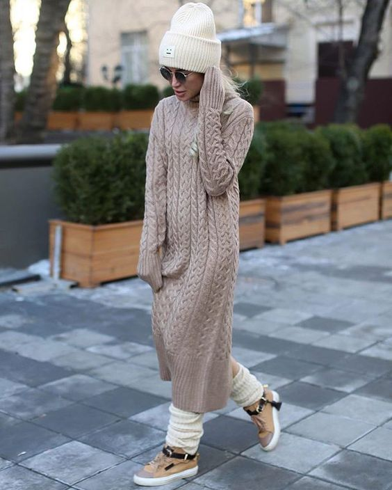 a blush sweater dress, a white beanie and legwarmers, sneakers for a sport chic look