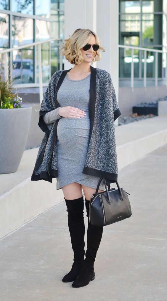 a grey over the knee dress, black suede boots, a poncho and a black bag for comfort