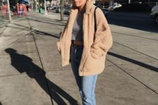 08 a grey tee, a fuzzy faux fur coat, blue cropped jeans, white sneakers for a cold fall day